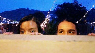 girl friends eyes peek-a-boo
