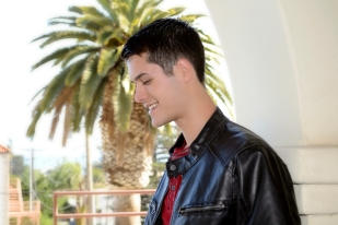 Smiling young man, high school senior. leather jacket