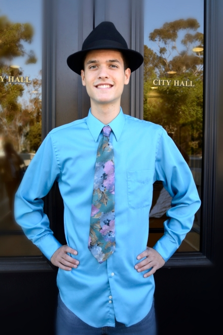 Smiling young man, tie and detective hat, City Hall