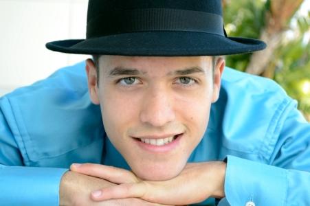 Smiling young man, hat, gazing
