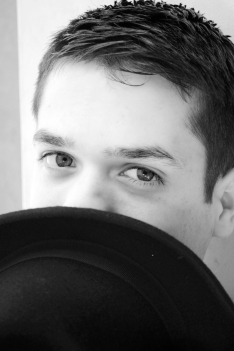 Young man, black and white, curious gaze