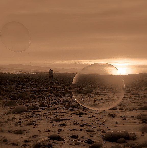 couple looks at sunset, two bubbles in foreground. monochrome sepia